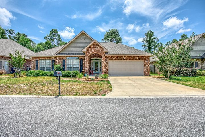 This stunning 3 br 2 bath brick home is located in the highly desirable community of Peach Creek. The home has freshly installed cherry laminate floors, updated kitchen, back-splash, center, island, crown molding in master. One of the most relaxing outdoor entertaining areas with a large floating deck, water fall, and separate patio for lounging or a fire pit. Protected wildlife area behind the home. Within a couple of miles of new schools, 5 minutes to the beautiful beaches and all that 30A has to offer. Walk down to the intercoastal waterway and fish, kayak or boarding. A great community for all ages. .