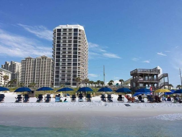 This condo has one of the lowest HOA's in the area that is located directly across from the Beach with so many amenities that you or your guest wouldn't need to leave the community unless they so desired. Offers Pool, Hot Tubs, Restaurant, Spa, Tennis, Shuffle Board, Laundry, Fitness Center, Event Center, and it's own Walk over walkway to the Beach.  Great rental history that  was converted to a 1 bedroom and updated,  offers a very large patio with private entrance on the 1st floor.  Only expense is your Electric and private Insurance....What are you waiting for join the vacation rental family today and have your private hide a way whenever you want with the most Beautiful Emerald Coast Waters and White Sandy Beaches that you could ever ask for!!