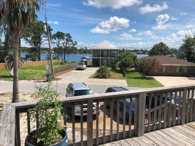INVESTMENT OPPORTUNITY! This property has clear lagoon views and is within walking distance to the Dolphin public boat ramp on South Lagoon and just a few blocks from the beach.The owners replaced the roof after Hurricane Michael, however there are more repairs needed. This home is currently used as a 3 bedroom 3 bath single family home but was transitioned by the previous owner from 3 1 bedroom 1 bath units. Turn it into your personal dream home or convert it back for an income producing property. The possibilities are endless!