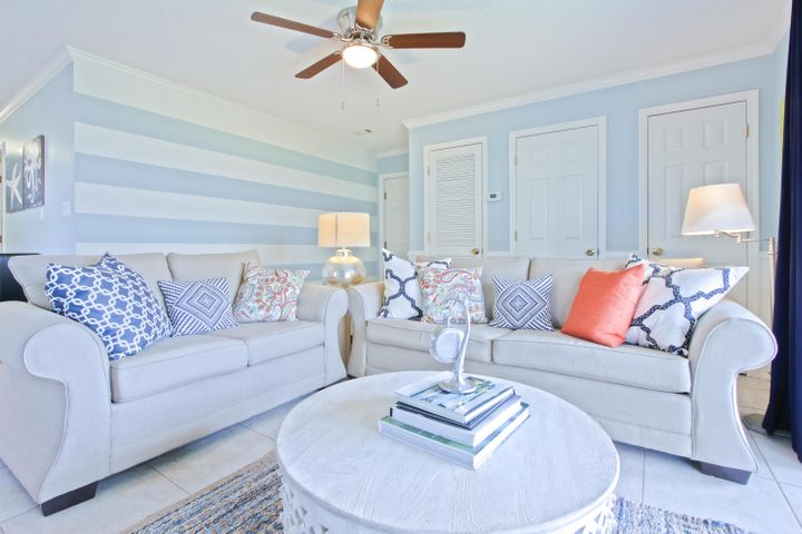 Stunning and elegant, this two bedroom, two bath condo is the creme de la creme of Beachside Villas. Located between Seaside and Rosemary Beach, this property is on the south side of 30A and only 50 steps to the beach access. New granite countertops and stainless appliances service the sparkling kitchen. The living and dining area feature sumptuous furnishings and decor, including a sleeper sofa. Views from the living room and large patio are of lush green space and snow white dunes (one of the rare units without parking lot views). The master bedroom has the feel of a luxury hotel and the guest bedroom hosts a pair of twin beds. Both bedrooms and bathrooms have new wood-look tile floors. The property features tennis courts, BBQ grills and two sparkling pools (one seasonally heated).