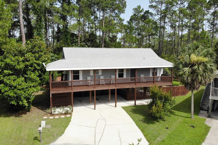3BR/2BA home on a quiet cul-de-sac, located just 2.8 miles to Gulf/Beach access & just 1.2 miles to Cessna Landing Park which offers boat launch, fishing pier, picnic pavilion, basketball, & playground. This home is situated on a .23 Acre lot & backs to a large preserve area, owned by the HOA. Entering the home, you are greeted by a large wrap around balcony and open floor plan with split bedrooms. The kitchen features plenty of cabinet and countertops space, dining area, & pantry with washer/dryer hookup. The master bedroom is large with a jetted tub, separate shower, & walk-in closet.  There is also two additional bedrooms and a full-size hallway bath.  Also available are an engineered stamped and county approved plans to enclose underside of the house for a mother-in-law suite.