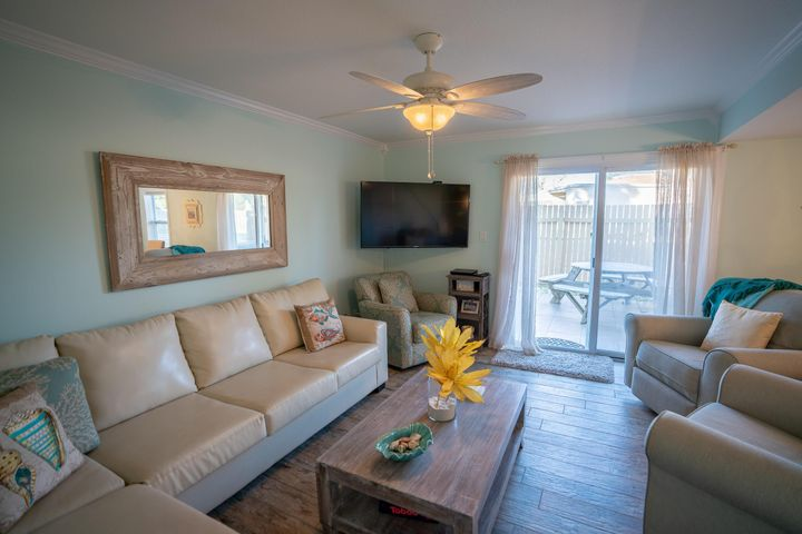 This fully renovated and upgraded condo located in Horizon South is a must see!! Horizon South is a gated community on the West end of Panama City Beach with numerous amenities and deeded access to the beach. Enter the foyer on to a beautiful custom design mosaic tile floor. The charming kitchen, den/dining and all bedrooms have wood look ceramic tile floors and crown molding. The kitchen has a built-in microwave, glass top stove, refrigerator and dishwasher with custom tile backsplash, quartz countertops, recessed lighting and upgraded cabinets with breakfast bar. Exit the den through upgraded sliding glass doors on to a private tiled patio with privacy fence. Located also on the ground floor is a laundry room, half-bath and inside under the stairs storage closet Upgraded windows and doors are on both floors.   Beautiful wood stairs with decorative iron railing lead to the large master bedroom with ceiling fan, his and her closets and master bath with ceramic shower with tub, custom cabinets, tile floor and quartz countertops.   Also located on the second floor is a guest bedroom with ceiling fan and a second master bedroom with ceiling fan, large closet and private tile floor balcony. An additional full bath on the second floor has a ceramic tile shower and quartz countertops.   As an additional bonus to this beautiful and pristine town home, a street-ready golf cart is included for your enjoyment.  It is the responsibility of the buyer to verify all measurements, fees, project facilities and what is covered by the fees.