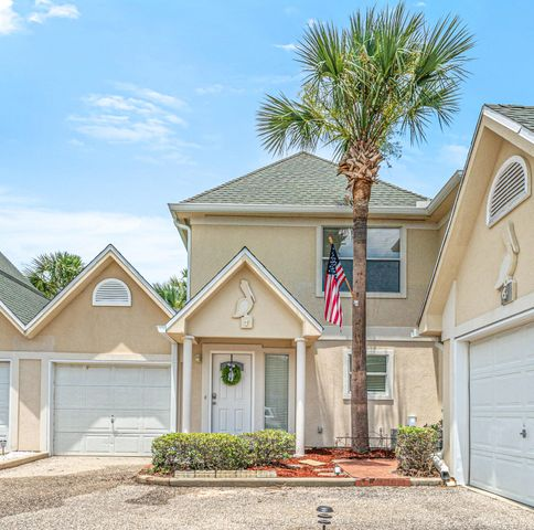 **Buyer defaulted!** Don't miss your opportunity to own this secluded piece of Destin!! Townhome is spacious with tons of character and lots of light. Private and secluded neighborhood in the heart of Destin. Close proximity to the Harbor and walking distance to popular restaurants. This place has updated and upgraded kitchen and bathrooms complete with granite and new subway tile backsplash. Very large master suite with lots of natural light. Recessed lighting throughout. Private back patio area. Large sitting bench in the living room perfect to read a book on or drink your morning coffee. Cute cut outs in the living room walls to display art or photos. Pool for the townhome residents.  Don't miss this gorgeous place!!