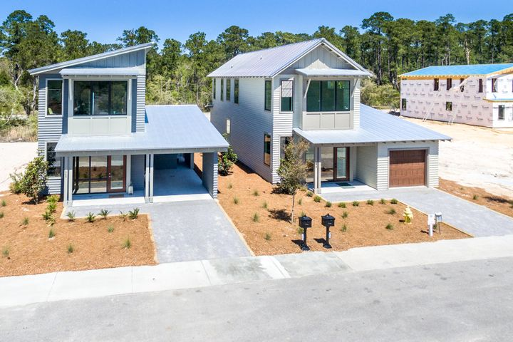 Two completed homes with same floor plan.