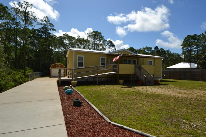 Affordable Home Sitting on 2 lots 50 x 125 each for 100 x 125 total and Just a short ride to Santa Rosa Beach & Destin.  This 3 Bedroom, 2 Bath 1512 SF Home Features 2x6 Exterior Walls, 1/2 Drywall, Whole House Ventilation System, 9' Trey Ceilings, 5'' Baseboards, 4'' Crown Molding, Ceramic Backsplash, Upgraded Residential Cabinets, 72'' Roman Style Bath Tub, Ceramic Walk-in Shower in Master Bedroom, Large Corner Lot with Cross Fenced back Yard, Metal Roof, 10x20 Covered front Porch with Handicap Ramp, Nest Thermostat, Whirlpool Washer and Dryer with pedestal Storage, Stainless Frigidaire Kitchen Appliances and Breakfast Bar and a Huge 12x30' detached Garage. The Home has been meticulously Maintained and is in Excellent condition. Call your agent today to schedule a visit.  All Measurements, Room Sizes and Ages are approximate. Please verify if important.
