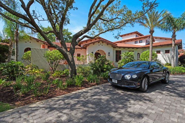 "Located just east of the 1,300 acre Naval Live Oak Nature Preserve peacefully rest one of NW Florida's finest estates - A sprawling 4 acre retreat along Pensacola Bay with rare, unspoiled natural beauty. As you pass along the meandering drive beneath 100 year old native Live Oaks, be prepared to be taken away as you pull around the grand circular drive that leads you through this magnificent estate. Inspired by the Spanish Colonial Revival design that's so beloved from Santa Barbara, CA to Boca Raton, FL - step back in time with the curved arches, hand painted tile, beamed wood ceilings, ornamental iron work and terracotta roof that is reminiscent of the fine architecture of the Spanish style mansions from the 1920's and 30's. Built in 2010 to the latest Miami-Dade hurricane codes, this concrete ICF constructed home is built to last to the end of time while seamlessly incorporating the latest in technology, amenities and energy efficiency. At 7,400+ heated/cooled sq feet with 6 bedrooms and 6.5 bathrooms, this retreat offers ample room for family and friends to relax in comfort. Open gathering spaces, expansive windows and doors that open to the pool and Bay to capture those moments of laughter, joy, companionship and breathtaking sunsets that renew and invigorate the soul. Bayfront living along the Gulf Coast offers a bounty of recreational activities that change with the seasons. From boating to paddle boarding, water skiing to fishing â¬"" there's so many activities to enjoy just steps from the door. There's something for everyone including the automotive aficionado - In addition to the 3 car attached garage there's also a 3,000 sq foot car barn that houses a 600 sq ft care takers quarters too! Enjoy the amenities and location 2530 East Bayshore has to offer. In less than a 20 minute drive you are within an International airport, a Downtown with fine dining and shopping, Top rated Golf courses, Yacht clubs and the World's whitest Beaches."