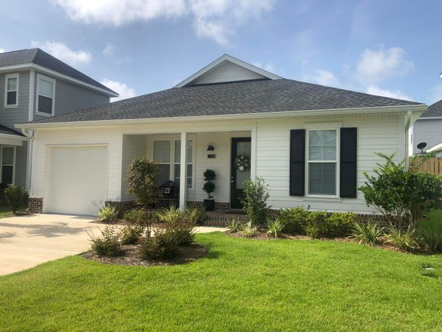 EXCEPTIONAL 2018 COTTAGE HOME. UPGRADES GALORE best describes this single-story 2br, 2bth w/a Office/Bonus room, SCREENED PORCH & 1 car garage home. Bonus room is a big plus & large enough to be a guest room.  The lovely kitchen adorns QUARTZ countertops, soft-close cabinetry, backsplash, GE stainless appliances & under cabinet lighting. Dining has a standout custom display cabinets, Spacious Master suite holds a wonderful California closet w/Barn door in addition to the privacy Barn door installed for 2nd bd rm quarters. Core-Tec LVP flooring throughout & porcelain tile in bathrooms. 9'ft ceilings, 8'ft doors, recess lighting & designer finishes throughout.  The details of this home sets it apart from others in this price range. Bar None, the best overall quality & value in the area!