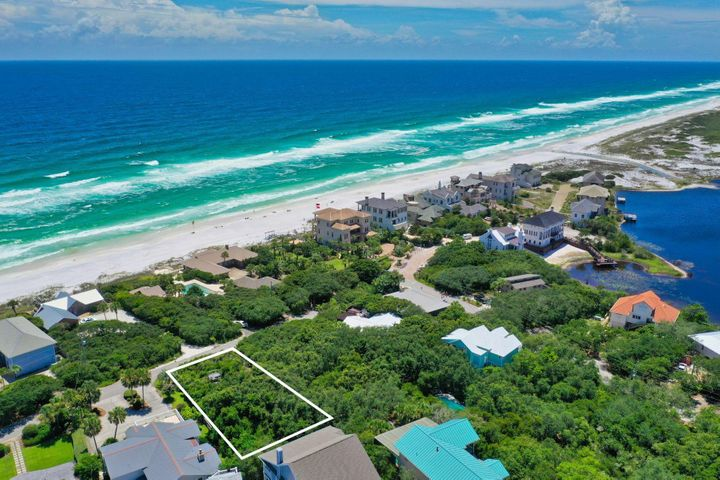 Enjoy breathtaking Gulf views from a high elevation home site in Beach Highland! Beach Highland is protected by its own Neighborhood Plan and Association with no HOA dues. The neighborhood offers Deeded Beach Use for owners. Rare opportunity to own a very private quarter-acre, 75x150, second tier lot and just four lots to the beach access at Stallworth Preserve. Once on the beach, you can walk to the west for a mile or more through the Topsail Hill State Park enjoying the nature of Stallworth Lake and other coastal dune lakes along the way. No build out time and no HOA!! There is a wooden observation tower built on the property that you can access for viewing.