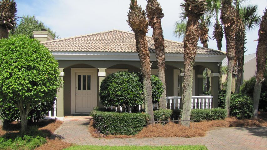 Live, work, and play near the beach!  Cute Florida Cottage at Terra Cotta Terrace.  Walk to the beach (Private Beach Access)!  Fresh paint, new refrigerator and dishwasher.  Nice wood deck in back.  Tile floors, crown molding, 9 foot ceilings! Tiled wood burning fireplace!   House has brick walks and driveways, tropical landscaping with lots of Palm Trees and Oleanders!  Short walk to the beach!  Amenities include  Private Beach Access, Clubhouse, Heated Community Pool, Sand Volleyball, and Tennis!  You'll love this private getaway near the beach!      Dimensions are approximate and should be verified if important.