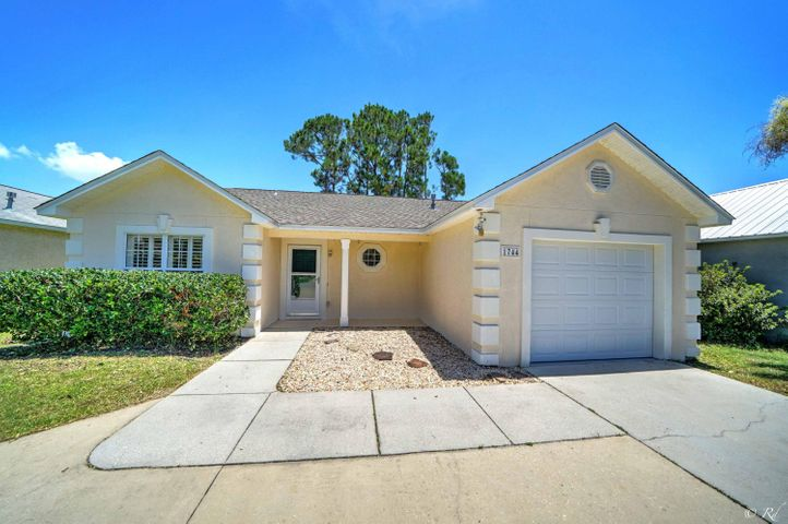 Move in ready beach home! This quaint 3/2 is conveniently located off Back Beach Road in the Allison Trace subdivions. Many recent updates including new roof, paint, floors, lighting, resurfaced cabinets and more. There is a circular driveway for extra parking along with a one car garage. The outside patio is perfect for entertaining with a built in bar, unique wall mural and other decor.