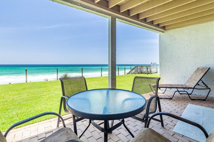 Your private patio over looking the sugar white sands and emerald green waters.