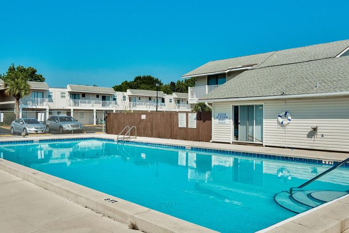 Low HOA Fees! 2 bedroom townhome in Destin under $145K!  Perfect for primary home or investment property.  Features include stainless appliances, new roof in 2012 , HVAC in 2012, new chair height toilets in 2015, fence (left side) replaced 2017, new interior paint, tub/shower and new ceiling fans in July 2019. Large paver patio offers low maintenance and plenty of room to host cook outs.   Centrally located in the heart of Destin, this property is within walking distance to shopping, grocery stores, banks, churches, retail stores, restaurants, entertainment and just a short drive to the several nearby beach accesses and the Destin Harbor.Community park right next door offers playground equipment and basketball and tennis courts. Don't forget the community pool for those hot summer days