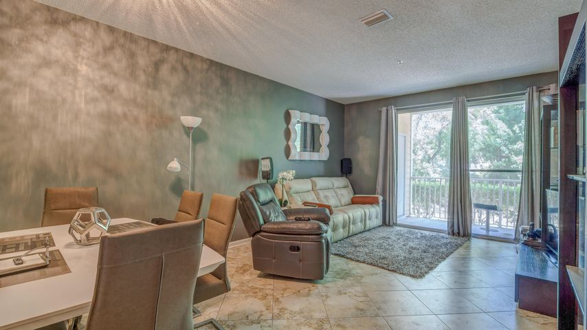 Highly sought after 2 bed 2 bath GROUND FLOOR UNIT. Tenant occupied on month to month lease. Tile floors in the main living area and carpet in the master bedroom. Pointe of View has a community pool and fitness center. Walking distance to Grand Boulevard, Publix, Sacred Heart Hospital, and Boulevard 10 movie theater. Just minutes to the beaches of the Gulf of Mexico. Short term Rentals Allowed. Seller is offering $2,000 towards new appliances.  Buyer to verify all info and measurements.