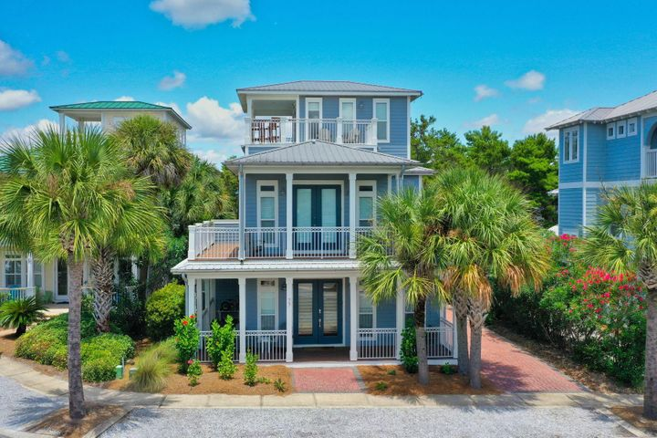 Occupying one of the most coveted locations in Seacrest Beach, this impeccably furnished beach home boasts a larger 50 x 100-foot lot backing onto peaceful green space. Spread over three floors, this newly remodeled property has four bedrooms, three bathrooms and a bright open floor plan newly decorated inside and out. Hidden nooks and porches on every level provide space for reading, relaxing, al fresco dining and sunbathing  whatever your perfect day includes. Wood flooring extends throughout the bright open living space with its full-height windows and deep tray ceiling. Gather for breakfast around the white granite island in the newly updated kitchen and end the day enjoying a family meal at the refectory table in the dining nook. With two bedrooms on the first floor and a bunk room for four young guests, this splendid coastal cottage provides a versatile space for vacation rentals when not in use by the owners. The top floor landing doubles up as a den or second sitting room with doors leading onto the deck with wet bar for enjoying cocktails and refreshing coastal breezes at sunset. Granite vanities in the master bathroom and a corner jetted tub add to the sense of upscale pampering along with the fully tiled oversize shower. A separate laundry room and two owners closets provide extra storage for beach supplies. Close to the magnificent 12,000 square foot lagoon pool, sunny days can be spent enjoying the water cascades and pools, or hop aboard the courtesy tram, conveniently located across from the home and head to the magnificent white sandy beach. You'll find miles of soft sand for walking, shelling, fishing and swimming in the emerald gulf waters. Bicycle trails provide a healthy eco-friendly way to get around the community. The Village of South Walton has first-class amenities and nearby 30A and leads to Alys Beach and Rosemary Beach for shopping, casual dining and live entertainment. Turn key and ready for your enjoyment. Call today to schedule a viewing
