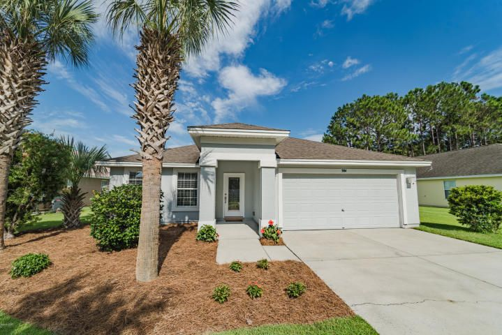 Incredible Palmetto Trace Home. The moment you walk in the door you will be impressed with how well taken care of and loved this home is. Sitting on a premium waterfront, pond lot, this home has it all. The other special wonderful features of this home include a large open kitchen, living area, a split bedroom floor plan with large master on one end of the home and other bedrooms on the opposite end. The home has been freshly painted inside and out. Not only is the home wonderful, the Palmetto Trace community has some great features such as..2 community pools, sidewalks and an incredible location across from Pier Park, Frank Brown Park and in close proximity to the beach!! This is why Palmetto Trace is one of the most sought out  developments in the Panama City Beach Area.Come see!!