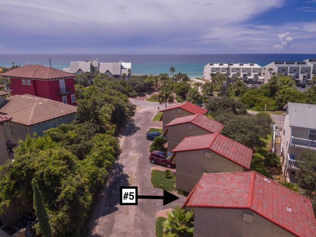 Here is your opportunity to own a great rental unit that serves as your 2nd home whenever you want to come stay south of the very popular 30A and escape to the quiet beach town of Blue Mountain Beach.  Just a short walk to a full facility public beach access, local eateries and fun boutiques, this brilliantly renovated unit is ideal.  The complete and recent renovation includes:  granite counters in the kitchen & master bath, stainless steel kitchen appliances, new vanities, toilets, sinks and showers in the bathrooms, hardwood floors on the steps, hallway and in the master bedroom, extensive trim package throughout, all new interior two-panel doors and hardware, custom built closets and shelving, built-in office area in master bedroom, bead board siding in the living room, staircase and hallway, private master bedroom door, updated lighting and ceiling fans, and custom sized window blinds.  Most furniture stays.  Please see list of furniture that conveys in attached documents.  This incredible townhouse with low HOA fees, south of Hwy 30A is ready to enjoy!   HOA fees include pest control, landscape maitenance, cable, wifi.  Pets are allowed for owners.