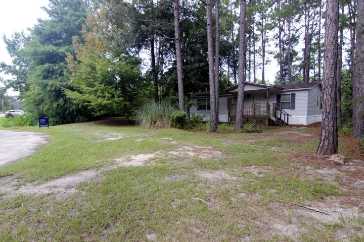 HUGE lot in Santa Rosa Beach! Cash buyer needed for this property as it is currently not insurable due to non functioning hot water heater and possibly roof too old. Great location and Great price for this fixer upper, use as primary home or as a rental property.  Large 16 x 12 shed in back yard for bikes, storage and lawn tools, well is housed in front with filtration system. Primary value is in the lot.