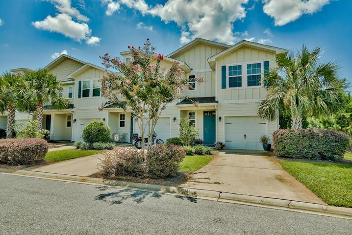 Phenomenal opportunity to own the best priced townhome at Water Oaks, an attractive community located just a mile from South Walton's beautiful beaches and Scenic Highway 30A, yet also close to Choctawhatchee Bay. This 3-bedroom, 2.5 bath townhome is ideally an end unit for additional privacy and slightly more square footage. There is beautiful curb appeal with the lush tropical landscaping and covered front porch including a quaint sitting area. Enjoy the coastal Florida cottage design with hardiboard exterior and teal accent shutters and door. Interior boasts an open floor plan ideal for entertaining with the main living areas downstairs, access to a back porch, raised ceilings and crown molding. Tile floor extends throughout the first floor and there is a half bath for convenience. The kitchen features granite countertops and a breakfast bar perfect for casual dining. It is well equipped with stainless steel appliances, beautiful wood cabinetry and ample storage with the pantry. There is an additional dining area and recessed lighting. The upper level encompasses all 3 bedrooms including a spacious master bedroom with a walk-in closet and en-suite bathroom featuring a double vanity and granite countertops. Both this room and one of the bedrooms feature crown molding and the carpet is about a year old. Two more bedrooms share an additional bath also with granite countertops. There is a laundry closet large enough for a full size washer & dryer (excluded). The one-car garage has updated flooring for easy maintenance and an added storage system.   This home has been well-maintained and the pride of ownership is apparent. It is a fantastic full time residence or an ideal investment due to the affordable cost, long term rental capabilities and easy maintenance. This is a prime location close to many dining, shopping and entertainment options within Santa Rosa Beach & 30A plus you are also close to Sandestin & Grand Boulevard. Just down the street is Louis Louis, which
