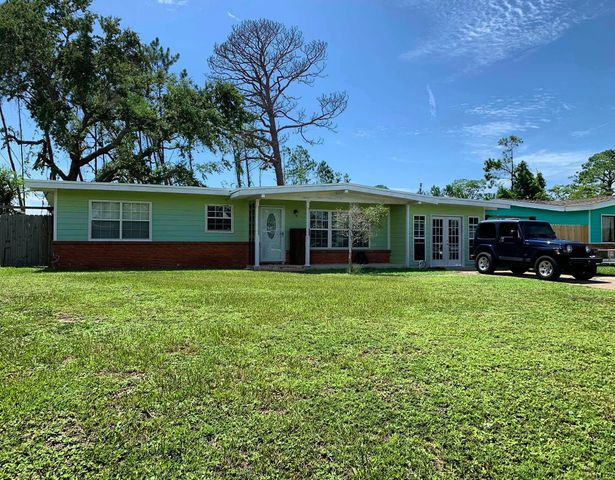 HOME IS CURRENTLY UNDER CONTRACT BUT ACCEPTING BACKUP OFFERS. This home has 2 beds (could be 3 easily or an office area). Highly desirable Woodlawn neighborhood near the bay, the Navy Base, Panama City and Panama City Beach