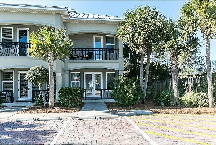 Conveniently located to shopping, restaurant's, and the white sandy beaches of the Emerald Coast this fabulous townhome is a must see. This home offers granite counter tops in the kitchen and all bathrooms. Newly installed wood plank tile in downstairs master bedroom, second floor bedrooms and hall. Balconies for each bedroom. Property offers 4 bedrooms, 4 bathrooms and will sleep up to 15 people. This makes it prefect for the large family and for vacation rentals. Property is currently on the rental program at Kimberly Lang Vacation Rentals and has a proven rental history grossing $36,462.96 for 2017 with owner usage during peak seasons, $36,106.32 for 2018, and$46,669.61 for 2019. Updated photos will be posted after completion of work,