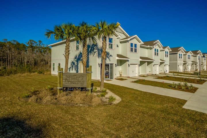 Beautiful Townhome located just North of Hwy 98 in Santa Rosa Beach. Granite kitchen and bath countertops, Stainless appliances include a stove, microwave and dishwasher. Recessed LED lighting in kitchen and living room. EVP flooring, carpet in bedrooms stairs and second floor hallway. Two car garage, auto garage door openers, 9' ceilings and interior doors with brushed nickel hardware, Located just minutes away from famous CO Hwy 30a, some of the country's best beaches, incredible shopping, and world class dining. Miller's Crossing is in a central location to both Destin, and Panama City Beach, allowing you to enjoy the best of both worlds. Walking distance to Alaqua Unleashed Dog park, Padgett Park, nature trails and public library. Pictures, photographs, floor plans, elevations, features, colors and sizes are approximate for illustration purposes only and will vary from the homes as built. Home and community information including pricing, included features, terms, availability and amenities are subject to change and prior sale at any time without notice or obligation. For Move-In/Completion Estimates: Ready dates are estimates only. Timing of completion of construction and buyer move-in are subject to contingencies contained in home purchase agreement and governing jurisdictions issuance of a certificate of occupancy, and may change due to forces majeures and other delays or disruptions outside the reasonable control of D.R. Horton, Inc