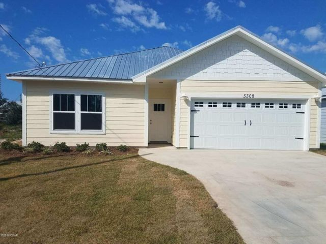NEW CONSTRUCTION! Home will be completed by 7.31.19 and ready to close. (photos are of same home that has been built next door). This brand new beach home is located off Thomas Drive near many public boat ramps and beach access points. The home features hardi-like siding, metal roof, wood look plank tile, granite throughout, coastal trim package, and more. The kitchen has soft close drawers and doors, backsplash, stainless appliances and a HUGE island with storage. The master bath is a dream come true with a large double vanity, soaking tub, tiled shower, separate toilet, large walk in closet and mirrored doors.