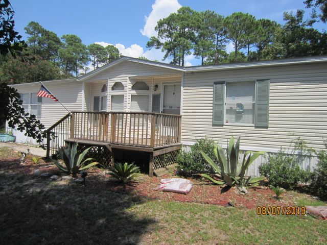 Large 3BR/2BA  Manufactured Home with 1759 Sq. Ft. of heated and cooled space.  New electric stove and new build-in microwave. New hot water heater. Beautiful and private back yard with fencing. Two storage sheds.  Established neighborhood with primarily owner occupants.  Public water and sewer and also a yard well for irrigation. There is NO HOA and thus no monthly fees. Less than a block from the Choctawhatchee Bay.  Property is actually four lots equal to over one half acre.  Make this your permanent home or an investment for excellent rental income.