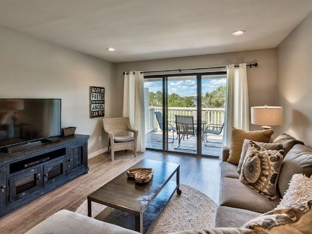 Renovated above and beyong! Front row seats to the weekly fireworks display, boats in the marina and sunsets that are off the charts! All furnishings included in this turnkey condo perched overlooking the signature hole 14 of the Links golf course