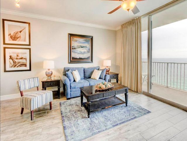 LOCATION, LOCATION, LOCATION!! Enjoy one of the resorts with the most amenities in all of Panama City Beach-TIDEWATER! Unit 1915 is a nicely furnished 1br/2ba gulf front condo at this mega-beach resort that also includes a medium storage unit. Stunningly excellent 180 degree panoramic views of the sparkling emerald green gulf waters and white sand beaches from sunup to sunrise. Close to the east end of the building, unit 1915 offers 923 sf of pure comfort. The unit can sleep 6 comfortably and is tastefully decorated, featuring distressed wood ceramic tile throughout for easy care maintenance. Kitchen offers granite counters and a full array of white appliances and front loading washer and dryer. Custom draperies add to the contemporary colors and decor. Two full bathrooms for your convenience. Great rental investment property with on-site rental desk. Tidewater is a vacation rental dream with 2 outdoor pools, indoor pool, tiki bar, restaurant, steam/sauna, fitness room, full movie theater, convenience store, beach service, gift shop, covered garage parking and on site rental and assoc. mgt. Located just west of the nearby Pier Park Shopping Mall and all area dining and activities. Unit 1915 at Tidewater is a MUST SEE! Exclusions: Two free standing tall wood decorative pieces in the living room.