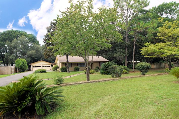 Home located on 1/2 acre lot with pool