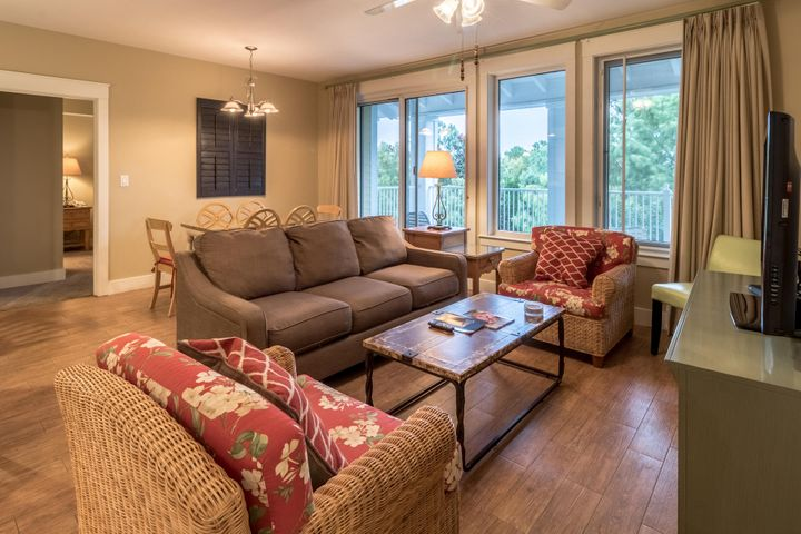 "Looking for an investment?  This A-rated 5th floor two-bedroom unit with updated flooring and large private deck overlooking mature trees can be rented 3 ways: studio, one-bedroom, or two-bedroom unit. Combined 2018 gross rental revenue of $40,346 and 2019 YTD through June: $24,031.  Owners have access to their own storage unit and owners private parking area.  Offered furnished and rental ready.  Pilot House is adjacent to the Village of Baytowne Wharf, a pedestrian market place that hosts a variety of dining and shopping as well as day & night activities.  As an introduction to the Sandestin lifestyle, we invite our new owners to explore amenities that make Sandestin special. The listing brokerage and seller(s) are presenting the buyer(s) of this property with (2) 90-minute rounds of tennis court time, a golf foursome at one of our three championship courses, a round of golf for up to four (4) players and an invitation to ""Club Night"" at the unrivaled Burnt Pine Golf Club. Sandestin Golf and Beach Resort is a major destination for all seasons and all ages, has been named the #1 resort on Florida's Emerald Coast.  This magical resort spanning over 2000 acres is comprised of over 70 unique neighborhoods of condominiums, villas, town homes, and estates. The resort features miles of sandy white beaches and pristine bay front, four championship golf courses, a world-class tennis center with 15 courts, 4 resort swimming pools (and 15 private neighborhood pools), a 123-slip marina, a fully equipped and professionally staffed fitness center and spa, meeting spaces and The Village of Baytowne Wharf, a charming pedestrian village with events, shopping, dining, family entertainment and nightlife. For true golf cart community living, Grand Boulevard is just outside the resort gates and provides access to additional shopping, dining and entertainment - all without traveling on Hwy. 98. Come to Play, Stay for Life!"