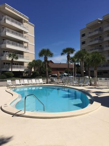 EASY COASTAL LIVING in this beautifully renovated condo located in the exclusive Sun King Towers Yacht Club.  The clubhouse is overlooking the Destin Harbor where you will enjoy front row seats to the fireworks and air shows.  Or take the water taxi to one of many restaurants right across the harbor.  The Clubhouse has a full kitchen, work out room, sunset deck, fire pit, grills and a large pool to keep cool. Keep your boat in the on-site private marina.  Boat slips are assigned by the dock master.  This completely renovated unit is stunning with 9' tall raised ceilings, crown molding, new mini-bar, beautiful wood floors, granite counter tops and upgraded fixtures.  Schedule a showing today before it's gone.  This unit will not disappoint.