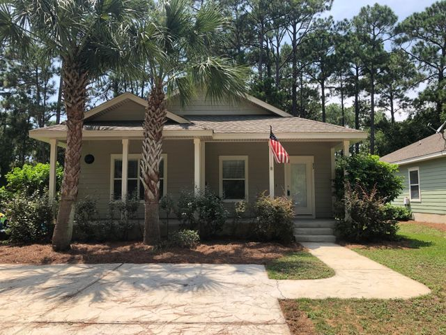 Beautiful Florida Cottage. Stone countertops in the kitchen, maple cabinets with crown, stainless steel appliances, cultured marble bathtubs & vanity tops, double vanity in master bath, walk in closet in master, 9 foot ceilings throughout, 20x20 tile everywhere except the bedrooms, porches on the front & rear of house and many other great features.