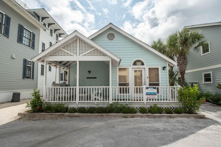 Kick back and relax in this cozy, beach cottage just steps away from the boardwalk in the most popular southeast corner of Grayton Beach. Excellent views of the lake and Gulf of Mexico from the front porch.Enjoy soaking up the sun on the beach or relax by the community pool. Newly updated interior with new hardwood floors, new kitchen, and updated bath area (2017). New outdoor enclosed shower with hot/cold water. Side patio with charcoal grill and chairs. New counter top, sink, stove, and microwave in kitchen. New Bosch gas stove. Little Blue is one of the closest homes to the beach in Grayton, approximately 100 yards to the gulf. King bed in master bedroom, 2 full beds in the 2nd bedroom and a sleeper sofa accommodating 8 guests.