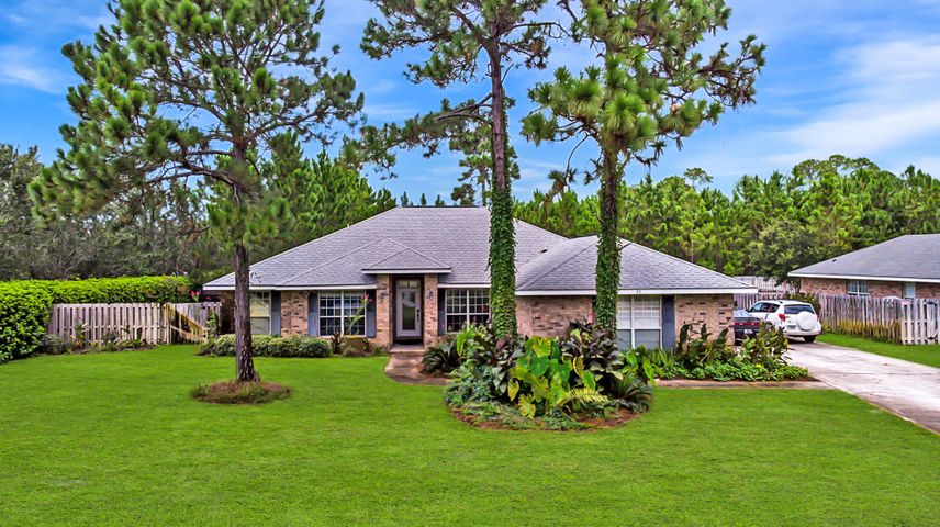 Priced more than $30k+ BELOW last sale!  Don't miss your chance to own a 4 bedroom home on just OVER a 1/2 acre LOT! Settle in with a HUGE family room, plus another den or formal living area, & extra large SCREENED in PORCH! The updated kitchen with corian counters & recent appliances has a breakfast bar, perfect for entertaining. Enjoy the privacy of a split bedroom floorplan. The master bedroom is over-sized w/ a gorgeous en-suite bath & TWO master closets, a garden tub & separate shower. There is new flooring and paint, but priced to bring your own ideas for this expansive space. Located close to the Bay & less than 5 miles from the Gulf of Mexico. Driftwood Estates offers a public park with a playground, tennis courts, basketball courts, bathrooms, picnic tables, walking trails & more!
