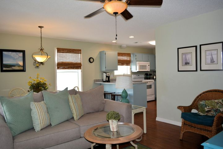 APPROXIMATELY 150 STEPS FROM THE GLIMERING BLUE GREEN WATERS GULF OF MEXICO.THIS LOVELY 2ND FLOOR 3 BEDROOM 2 BATH CONDOMINIUM IS RENTAL READY.  NEW GRANITE COUNTERTOPS IN THE KITCHEN. TILE IN BATHS, NEW CARPET IN BEDROOMS AND HARDWOODS IN KITCHEN AND LIVING AREA. THE PERFECT FAMILY GETAWAY THIS UNIT IS LOCATED OFF OF SCENIC 30A  IN A QUIET NEIGHBORHOOD ON THE EAST SIDE OF EASTERN LAKE BUT CLOSE TO FABULOUS MOM AND POP RESTAURANTS. NO CHAIN RESTAURANTS.  SELLING WITH EVERYTHING YOU SEE.  WINDOWS AND SLIDERS HAVE NEW GLASS .  ALL APPLIANCES EXCEPT WASHER AND DRYER ARE 2-3 YEARS OLD.  WASHER AND DRYER HAVE BEEN WELL MAINTAINED. A/C NEWER ALSO. RENTAL INCOME: 2017-$25,000 2018-$28,000 SELLER SAS RENTALS TO BE OVER $30,000 FOR 2019.