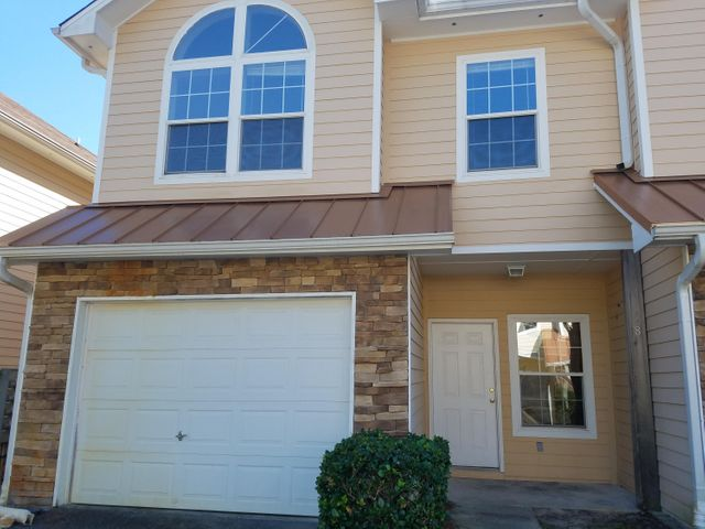 Why Rent when you can own for less?Wonderful 3 bedroom, 21/2 bath unit that has brand new kitchen appliances and lovely wood laminate floors throughout except tile baths upstairs.  Fabulous location just 11/2 mile from Sacred Heart Hospital in South Walton. This unit is vacant and ready for a new owner. Park in the garage. This is a best buy.  Perfect for second home, investor or primary residence. A pool is shared by 12 units. Great and convenient location, near Sacred Heart Hospital, Grand Boulevard shopping, Publix Grocery, Movie Theater, Excellent Schools South Walton Schools,(all grades)  Close to the white sand beaches.  Only 12 units in development.  POOL Close to Hwy 98. Enjoy Life in the panhandle of Florida.                    GREAT PRICE   -     GREAT PRICE  Unit is vacant and on Supra Lock box. THANKS AND HAVE A GREAT DAY.