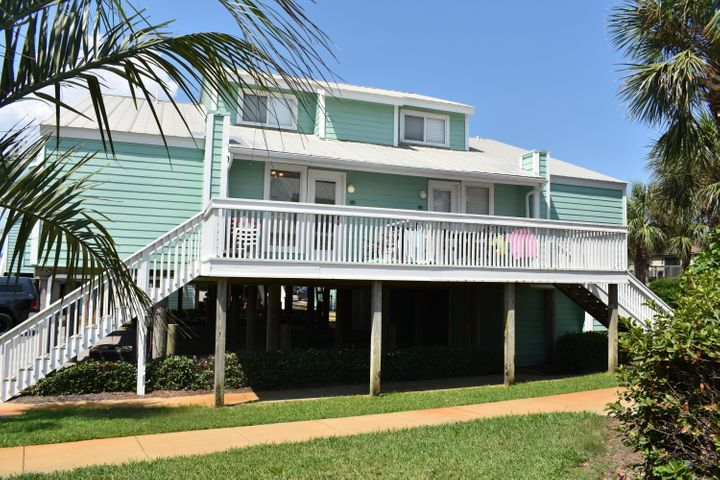* *  2 MIN. WALK TO BEACH & GULF VIEW FROM 10 x 13  DECK ! ! ! !  Stairs lead up to deck G view to S.E. of Gulf * *    2 tandem spaces + storage room in carport * *  Only been 2nd home for about 10 yrs. ** remodeled kitchen * updated bathrooms & tile floors * BUNK ROOM off living room * Upstairs loft bedroom has been extended and enclosed & added bath + washer/dryer.* AS IS *  Unit Backs up to 5C if wanted to join both units together, same family owns ***LOW $293Mo. Maint.Fee includes INSURANCE OUTSIDE, garbage,water, sewer. You pay interior contents, cable, internet, power *  EASY SHOW, VACANT, CALL LISTING AGENT & HOA MGMT. WILLA MERRIOTT REALTY FOR CODE TO KEYBOX * * October Owner meeting to discuss new roofs, which would require a super majority vote of owners for special assessment *