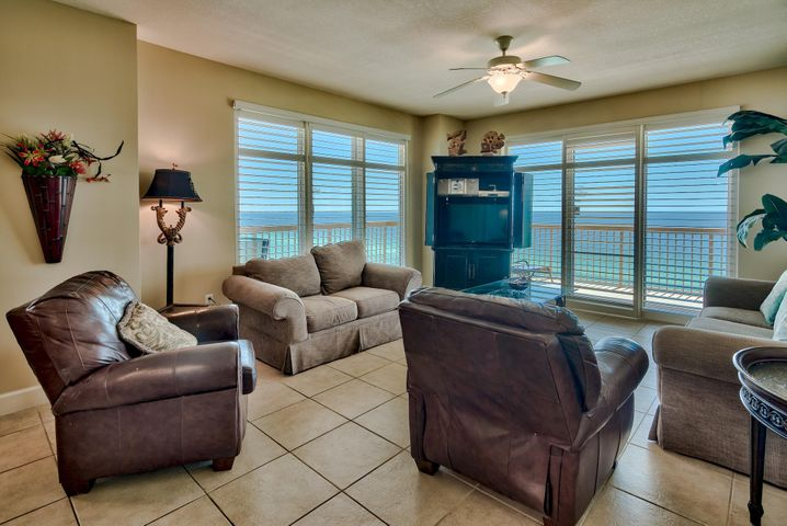 Phenomenal opportunity to own a 3-bedroom, 3-bath East end corner unit. Corner units rarely come on the market and this will not last long! Large windows and doors surround the unit bringing in great natural light and stunning views of the Gulf of Mexico. The spacious wrap-around balcony can be accessed from the living area or master bedroom and is the perfect place to relax, entertain and enjoy outdoor dining. Enjoy views of the Gulf of Mexico, shimmering white sand beaches and the expansive pool area. Exquisite details and features abound in this breathtaking unit. Interior details include an open floor plan, custom plantation shutters throughout, beautiful tile floors and stylish decor. This luxury unit is being sold fully furnished and decorated and is a prime turn key investment! There is a great formal dining area with views of the Gulf and an open kitchen with granite countertops, tile floors, and ample cabinets. The wrap-around granite breakfast bar is perfect for casual dining. The Gulf front master bedroom is separate from the other two bedrooms for added privacy. The master is very spacious with direct balcony access, custom plantation shutters, walk-in closet and en-suite bathroom. Enjoy your morning cup of coffee on the balcony while taking in the views. The en-suite master bath offers tile floors, double vanity, soaking tub to unwind in and a separate walk-in shower. There are two guest bedrooms - one with Gulf views and an en-suite bathroom and the additional guest bedroom has a separate bath nearby. There is a laundry room with a full size washer and dryer and extra storage. This unit is currently on a vacation rental program and has grossed $25.6k year-to-date but could do more as projected revenue is $40k.   Sunrise Beach has luxurious amenities including: 2 elevated Gulf front pools, one heated seasonally, 2 spas, large sun deck, spray park, owners lounge with full kitchen, Gulf front exercise room, theater, plenty of underground parking, Gulf fro