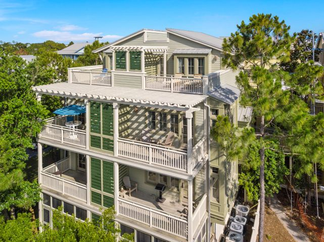 This spacious two-story beachside condo is just steps away from the WaterColor Beach Club and pool. It is also within walking distance to many other shops and restaurants located in this area. This unit offers 1 bedroom and two baths with a jetted tub and oversized shower. In addition, there is a queen sleeper sofa allowing this unit to accommodate 4 guests. Both porches are very large and from the top floor bedroom porch you can enjoy  views of the Gulf of Mexico and Western Lake. This unit is sold fully furnished and equipped with all of the luxuries you would expect in a WaterColor condominium. The Seller has also PAID IN FULL the amenity assessment for WaterColor!