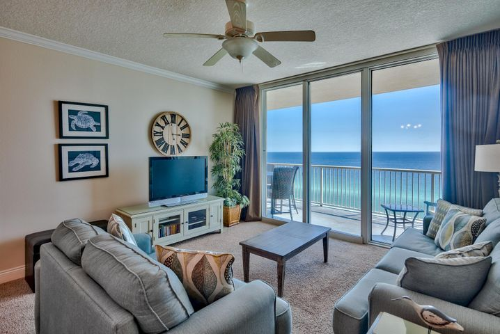 Looking for the perfect beachfront unit on the Emerald Coast? Take a look at Palazzo Unit #807, a fantastic 3-bedroom, 3-bath unit with a Gulf front master bedroom, expansive balcony and open floor plan. With four floors of underground garage, this is 12th floor elevation for amazing panoramic views of the Emerald Coast. The floor to ceiling sliding glass doors & windows enhance the Gulf views even more. Access a spacious 246 sq. ft. balcony from the living area and master bedroom, which is the perfect place to relax, dine or entertain. Interior offers a welcoming coastal feel and is very well maintained. The open floor plan and raised ceilings allow the unit to feel very spacious. Crown molding is a beautiful detail for the main living areas and master. Sold fully furnished & decorated! The updated kitchen is very open with a large granite breakfast bar & countertops, black appliances and plenty of storage with ample cabinets and pantry. Take in views of the Gulf of Mexico while preparing a meal. This floor plan is great for entertaining with the breakfast bar, dining area and living area combined. There is extra privacy for the Gulf front master bedroom which is split from the two guest bedrooms. The master suite is exceptional with direct access to the balcony, a large walk-in closet, spacious room with crown molding and walk-in closet. The beautiful en-suite master bathroom offers a Whirlpool tub to unwind in, double vanity, tile floors and separate walk-in shower. One of the guest bedrooms conveniently offers an en-suite bathroom with a shower/tub combo and a queen bed. The additional guest bedroom features two twin beds for extra sleeping accommodations and the guest bath is accessed from the hallway and has a pedestal sink and walk-in shower. There is a full size washer & dryer in the unit with storage above. This could be an incredible turnkey rental investment, second vacation home or full time residence.  Palazzo amenities include an elevated Gulf side poo