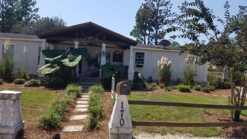 Fantastic location, close to  shopping, restaurants, hospital and Beaches of South Walton.  4 bedrooms with closets and an office.  Large living dining combo. Nice kitchen with granite counter tops.  Huge deck on rear and large building (11.4x22) in back that can be used for workshop and storage. Side yard is partially fenced for pets.  Park on both sides of home and in front.  There is room for an RV.