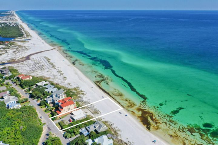 Prime legacy building site yielding approximately 80' x 250' directly on the beach perched at an impressive elevation presiding over unparalleled gulf vistas located on the coveted east side of Blue Mountain Beach Road along Scenic Highway 30A. This highly sought after location is one of the most opportunistic on 30A with an exceptional site layout to yield a spectacular finished product complete with underground power (no power lines) and a 50' vertical heigh limit situated on 80 linear feet of pristine white sand beach on the Gulf of Mexico. This premium site has a seawall currently intact and a small block beach house complete with 4 bedrooms, two living rooms and a carport that could provide temporary use while designing a permanent residence. Blue Mountain Beach Road is adjacent to Big Redfish Lake and within excellent proximity to central 30A including Seaside, Watercolor and Grayton Beach offering ample privacy & seclusion yet quick access to world class shopping, dining and local entertainment.