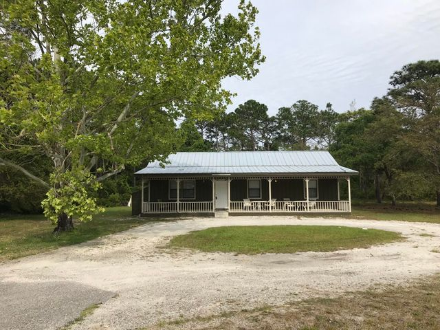 Looking for a Santa Rosa Beach locale to call home? Look no further! Adorable renovated home on over 1/2 acre with NO HOA available in Santa Rosa Beach near the hospital, shops & beaches! Potential for Village Mixed Use variance. This renovated 3 bedroom 2 bathroom home with huge covered front porch features all new flooring, new paint, new refrigerator and stove, new light fixtures, blinds, HVAC and back deck. Enjoy the open concept floor plan, large laundry room with extra shelving, pantry, hall linen closet and master suite with private bathroom. Relax on the extra long front porch. With over a half acre, there is ample space to park in the circular drive and room to build a carport or garage. There's plenty of storage with 2 exterior sheds. This gem won't last lon