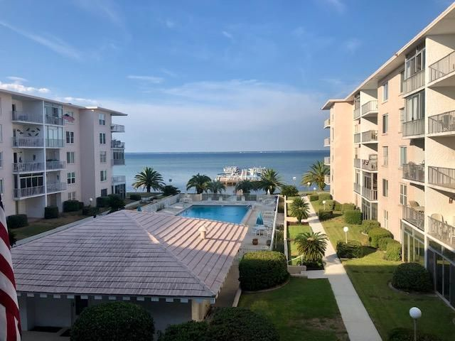 Boat Slip on the Bay!  Open living area leads out to a sizable balcony with views of the Choctawhatchee Bay! Condo comes with boatslip 3W. One Assigned Parking Spot!  Amenities include pool, community dock, picnic area, fishing station, assigned parking, and on-site HOA. This unit has plenty of storage! Washer and dryer room is close to the unit. The unit does come with extra storage closet on third floor. New Air Conditioner with heat pump was installed in July 2018. Unit has been updated with new refrigerator, stove,  bathroom vanity,  water heater, ceiling fans and pine flooring. No short term rentals or pets. Boat Slip fee is $215 a year.