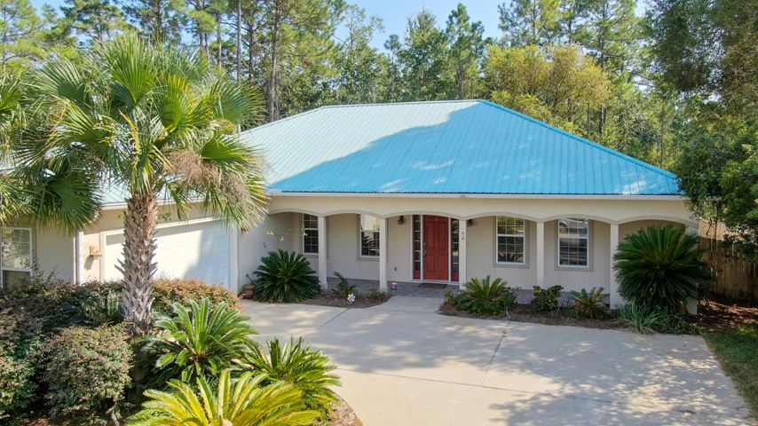 Priced to sell at $148/sq.ft! Sellers downsizing. MUST TOUR TO APPRECIATE! 3BR/3FULL BATHS, and 2 car garage. This Custom Designed Mediterranean Style Ranch flows from a large open living concept; living, dining and entertaining area into an oversized Screened Porch complete with tile flooring and ceiling fans. 9 foot ceilings with beveled designer crown molding throughout. Gas fire place and custom wet bar with cable ready access will appeal to sports fans! 3 sets of double glass doors provide view of beautiful fenced in back yard and natural light. All double doors and windows have new custom blinds. Well appointed kitchen with new granite counter tops and Kenmore Elite Appliances, including double wall oven and 5 burner gas stove top. Chef's paradise! Generous Master Bedroom carpeted with gas fireplace and sitting area. Master Bath is spacious with double granite vanity, tile, separate walk in glass shower, Garden Tub and spacious walk in closet. 2 additional guest bedrooms are connected by full bath and an extra full bath located off great room. All bedrooms have walk in closets. 2 year young AC unit and full home inspection available from 2017. Large storage area above garage. Buyer to verify all information.