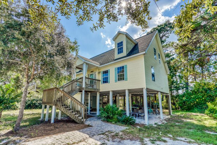 Nestled in the heart of Seagrove, this 4 bedroom, 4 bath home sits in a quiet, secluded neighborhood just blocks to the beach and many great restaurants.  The home features hardwood floors, stainless steel appliances, spacious bedrooms, an open concept kitchen and dining area with doors leading to a large screened-in porch, and an upper private lookout deck to gaze at the stars and listen to the waves as they crash onto shore.  Huge covered area underneath the house to grill out and entertain family and friends.  This home is being sold fully furnished and makes a fantastic rental property or a second home.  Claim your spot in Seagrove and live the 30A lifestyle with fantastic neighbors!