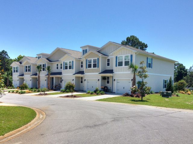 Great location with built in income! Located just minutes from the beautiful beaches of South Walton, this is a spacious 3 bedroom 2.5 bathroom town home. Enter from the front porch or the garage wood floors in the open concept kitchen/living/dining area, kitchen with granite and stainless appliances and a half bath on the first floor. Upstairs is the master with attached bathroom with double sinks, granite and separate tiled shower along with two guest bedrooms and a full bathroom. Currently leased - ask your real estate agent for details.