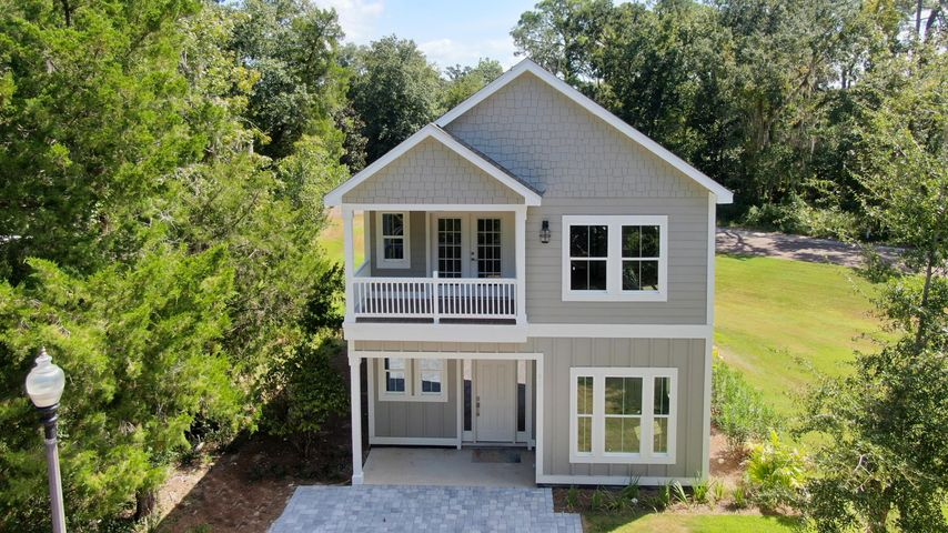 Brand NEW Construction in beautiful Sacred Oaks! The Stockton plan offers 3 bedrooms and 3 bathrooms. This home boasts beautiful designer finishes, an open concept living space, as well as guest bedroom and full bath downstairs! Features include custom tile in the kitchen and bathrooms; brick driveway; 9 foot ceilings; and energy efficient HVAC systems.  This wonderful waterfront community offers beautiful walking paths, large green spaces and a community dock. The HOA has approved a community pool as well.  Located within minutes of Grand Boulevard; this community offers incredible access to the bay, the beach, world-class shopping and high-end dining.