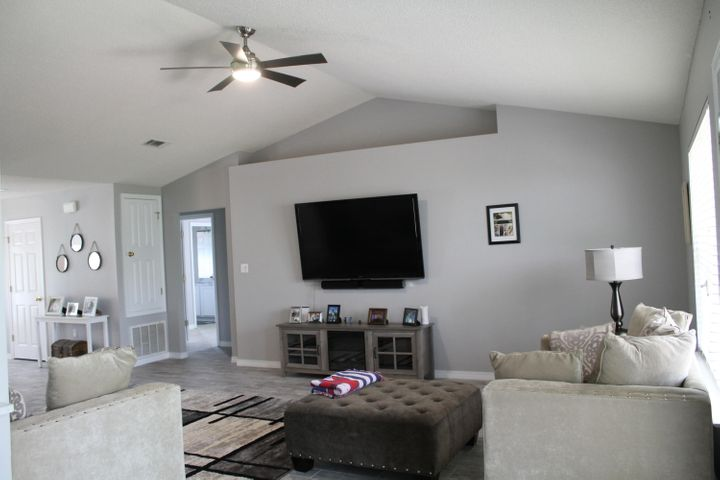 Immaculate 4 bedroom home in Mack Bayou Pointe Subdivision.  This home has all the upgrades. Vaulted Ceiling, formal dining, driftwood grey ceramic tile flooring, marble counters throughout, stainless steel appliances.  Large partially fenced back yard with raised entertainment deck overlooking the forest. Double car garage with Ryobi blue tooth connection opener that has 5 outlets for additional add on's. New Age Steel Garage Storage System and an extra refrigerator. Quiet neighborhood and a community pool offer the best in family living. Conveniently located only 1 mile North of Sacred Heart Hospital and close to Grand Boulevard, Restaurants, Silver Sands Outlet Mall and the beach! Make this your home TODAY!! Buyer to verify all measurements. Home Warranty Available.